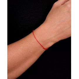 Védelmező piros zsinór karkötő